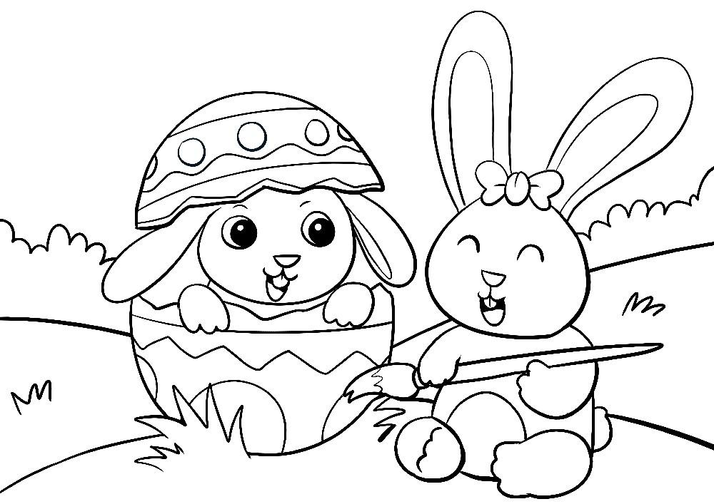Zwei Ostehasen bemalen Eier