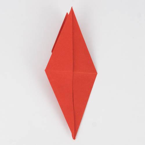 Dere Origami Kranich auf die andere Seite gedreht.