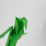 Die Krümmung im Schnabel des Origami Vogels falten